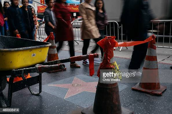 A general view is seen of the cleanup of Bill Cosby's star on the Hollywood Walk of Fame after it was defaced with the word 'rapist' on December 5...