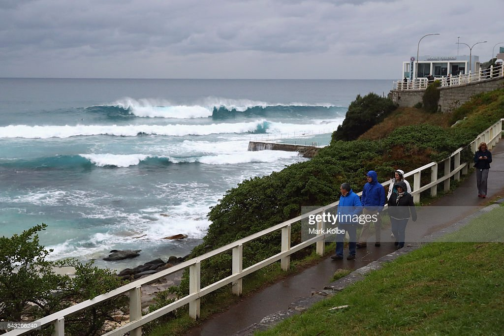 A general view is seen of visitors to Bondi Beach wearing winter jackets to counter the wet and cold conditions on June 27, 2016 in Sydney, Australia. Sydney experienced its coldest day of the year on Sunday, and more icy weather is forecast for later in the week when a second cold front hits later in the week.