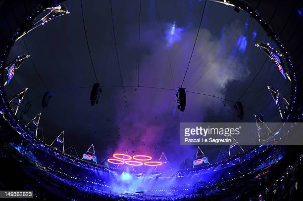 A general view is seen while the Olympic rings are assembled above the stadium during the Opening Ceremony of the London 2012 Olympic Games at the...