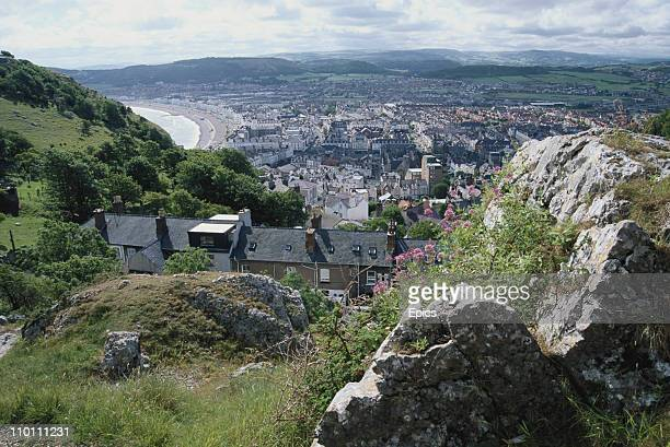 A general view looking south east across the coast and town of Llandudno Wales July 1997