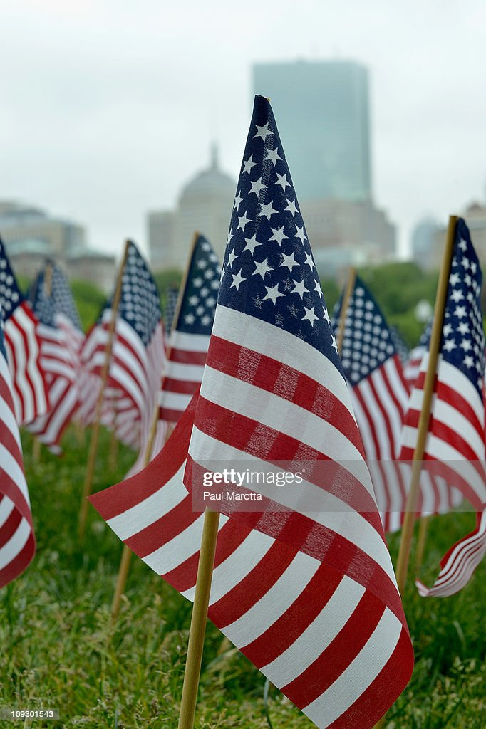 A general view of 33,000 American Flags on the Boston Common at the Soldiers and Sailors Monument on May 22, 2013 in Boston. Each flag represents a Massachusetts soldier or sailor who has fallen in the line of duty since the Civil War.