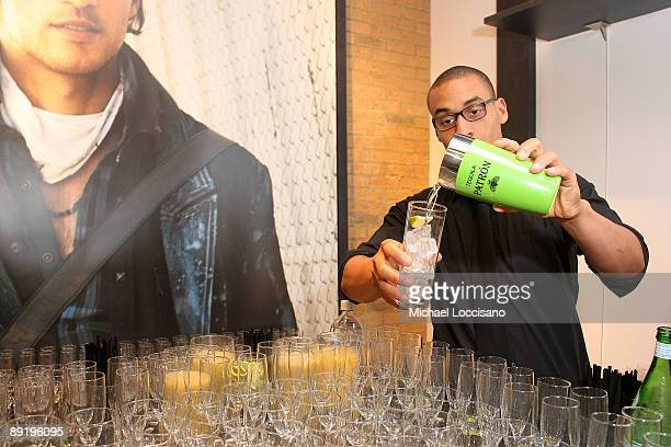 General view of a bartender mixing a drink during the GUESS Flagship Boutique opening hosted by Marie Claire and GUESS at GUESS Flagship Boutique on...