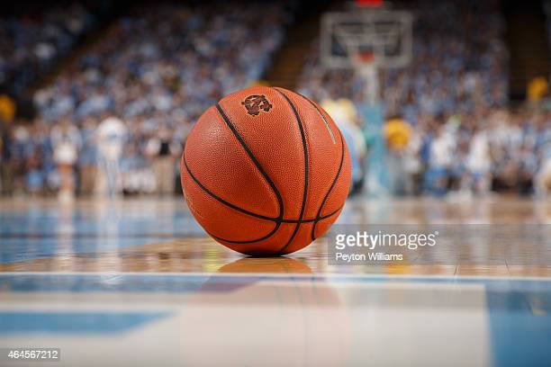 A general view of a basketball with the logo of the North Carolina Tar Heels sitting on the court during a timeout against the Syracuse Orange on...