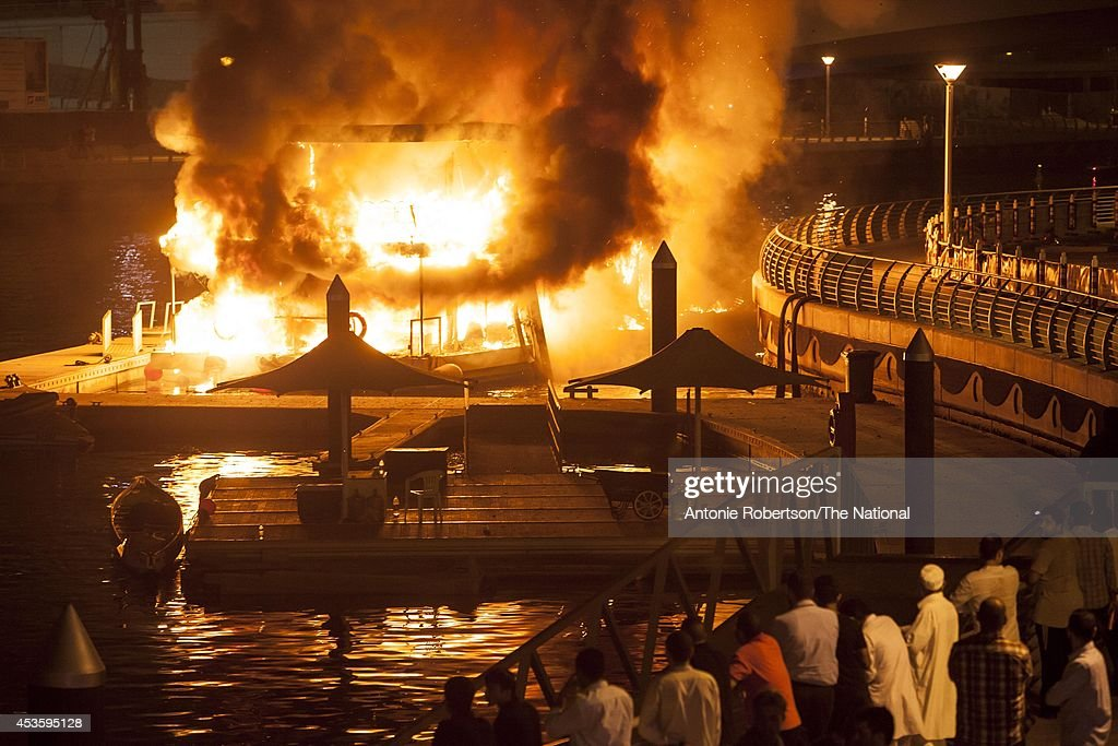 A general view of a boat ablaze, moored near Al Rahim Mosque in Dubai Marina on August 14, 2014 in Dubai, United Arab Emirates. Passengers were forced to jump out of the boat's windows to escape the flames.