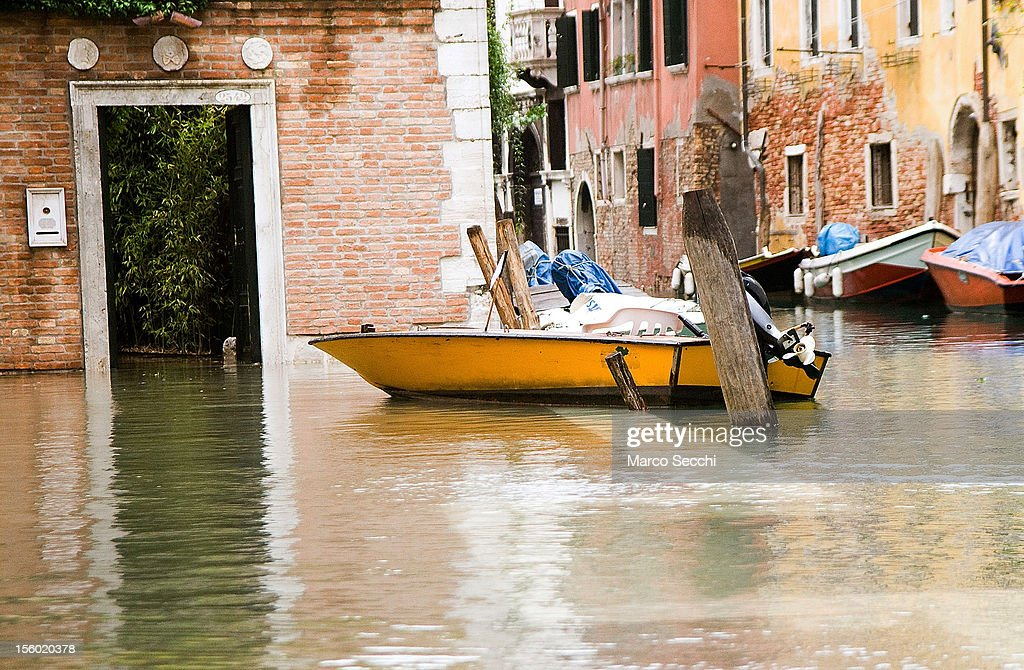 A general view of a boat on a flooded street during the exceptional High Water on November 11, 2012 in Venice, Italy. More than 70% of Venice has been been left flooded, after the historic town was hit by exceptionally and unexpected high tide. The sea level rose very quickly to 150 due as well to strong southerly wind and heavy rain.