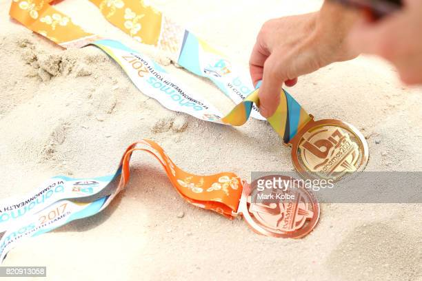 A general view of a bronze and gold medal being laid out for a photo is seen after the beach volleyball on day 5 of the 2017 Youth Commonwealth Games...