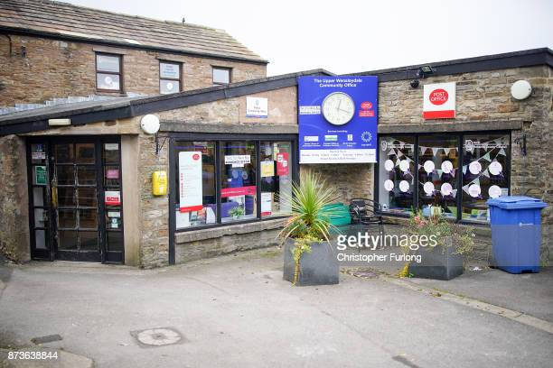 A general view of a building which houses the community run post office police station and library in the Yorkshire village of Hawes which is trying...