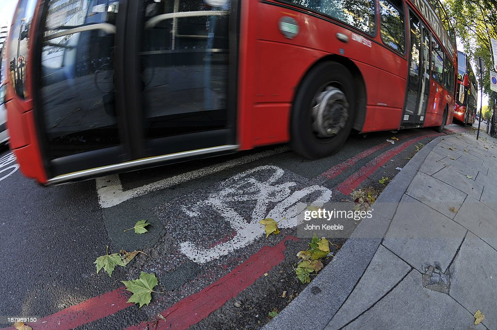 A general view of a bus cutting across a cycle lane at Old Street Roundabout on November 14, 2013 in London, England. Mayor Boris Johnson is under pressure to act on road safety in London after the recent deaths of five cyclists in nine days after collisions with busses and lorries, with former transport secretary Lord Adonis calling for an independent review of the cycling 'superhighways' in the capital.