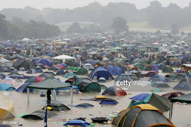 A general view of a camp site that has been flooded by heavy rain on the first day of the Glastonbury Music Festival 2005 at Worthy Farm Pilton on...