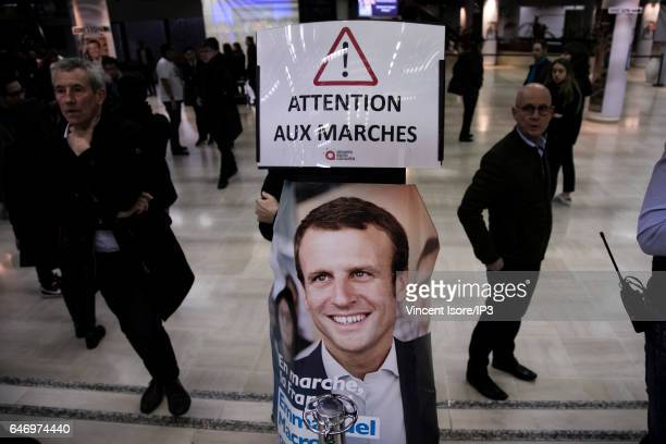 A general view of a campaign poster of Former French Economy Minister Founder and Leader of the political movement 'En Marche ' and candidate for the...