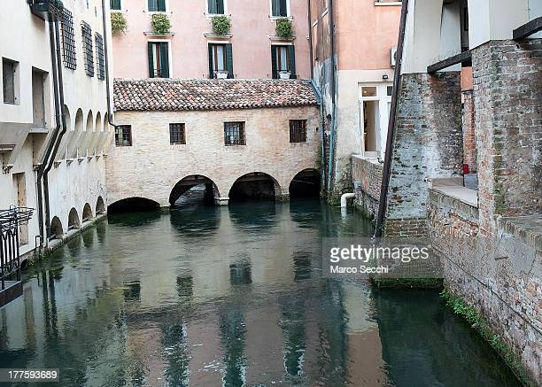 A general view of a canal and houses in Treviso seen on August 24 2013 in Treviso Italy Treviso claims that Tiramisu was invented in the 1960s by...