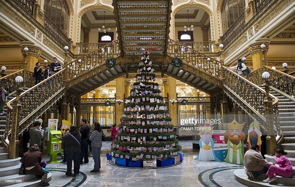 General view of a Christmas tree with children's letters for the THree Kings at the main post office in Mexico City on January 4, 2013. In Spanish-speaking parts of the world, children believe that the Three Kings receive their letters and so bring them gifts on the night before Epiphany. The Mexican Post Office opened this service to encourage the use of traditional mail.