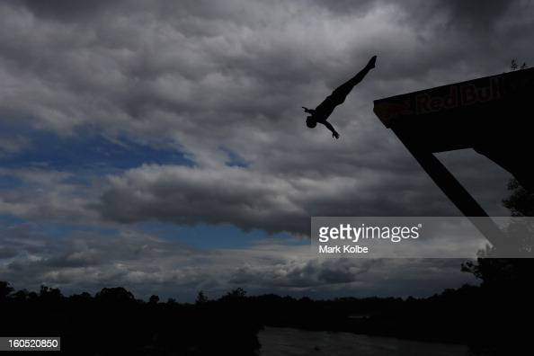 A general view of a competitor diving is seen during the Red Bull Cliff Diving qualifying round in the Hawkesbury River on February 2 2013 in Sydney...