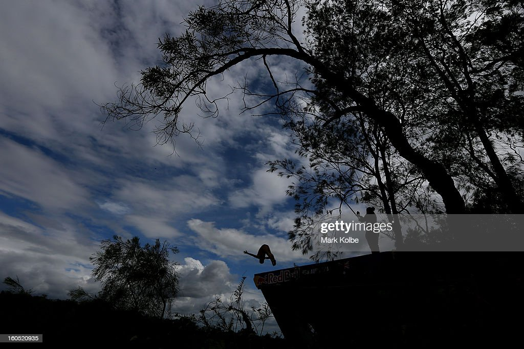 A general view of a competitor diving is seen during the Red Bull Cliff Diving qualifying round in the Hawkesbury River on February 2, 2013 in Sydney, Australia.