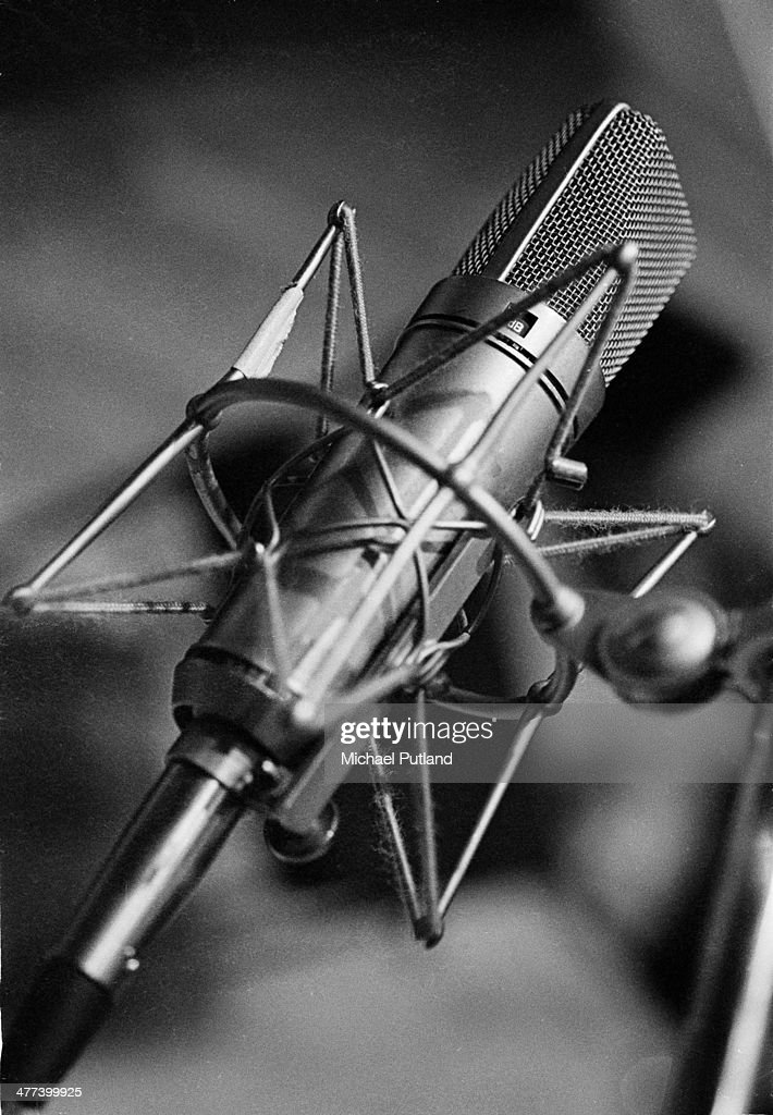 General view of a condenser microphone in a shock mount in a recording studio circa 1980