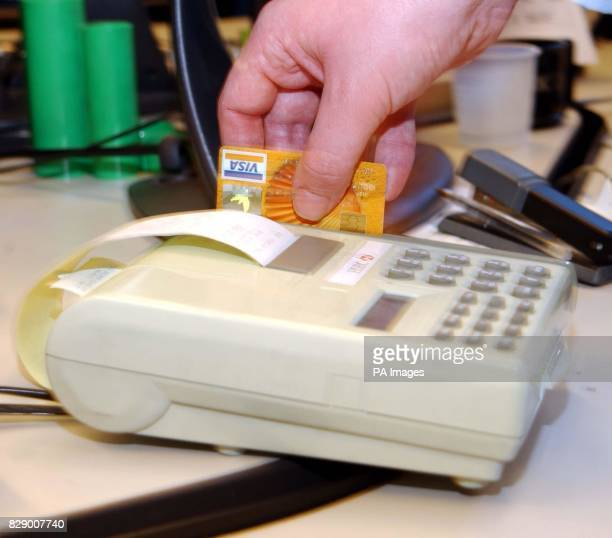 A general view of a credit card being swiped through a PDQ paying machine 19/7/04 Credit card spending looks set to fall during the summer and nearly...