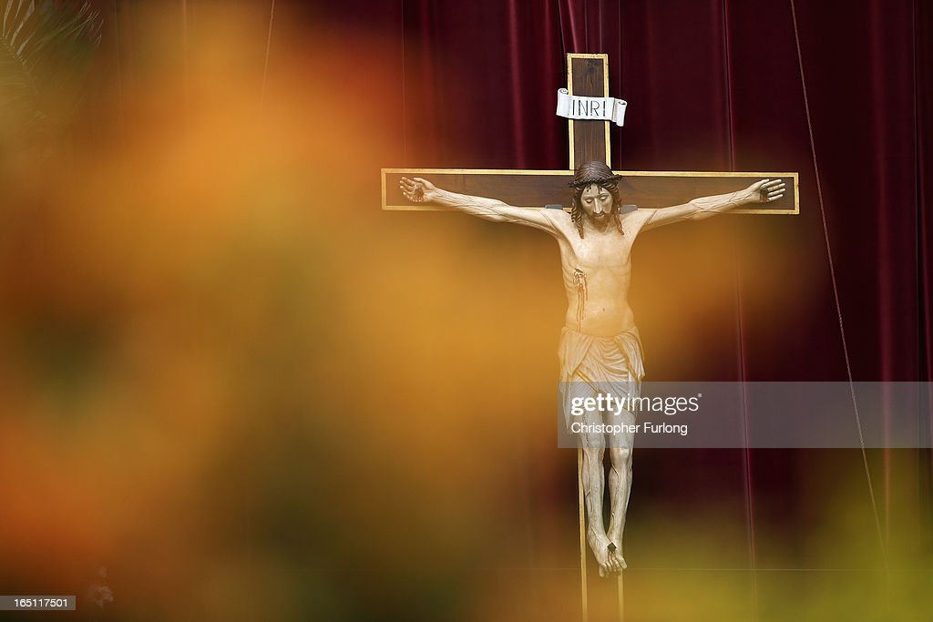 A general view of a crucifix as Pope Francis appears prior to delivering his first 'Urbi et Orbi' blessing from the balcony of St. Peter's Basilica during Easter Mass on March 31, 2013 in Vatican City, Vatican. Pope Francis delivered his message to the gathered faithful from the central balcony of St. Peter's Basilica in St. Peter's Square after his first Holy week as Pontiff.