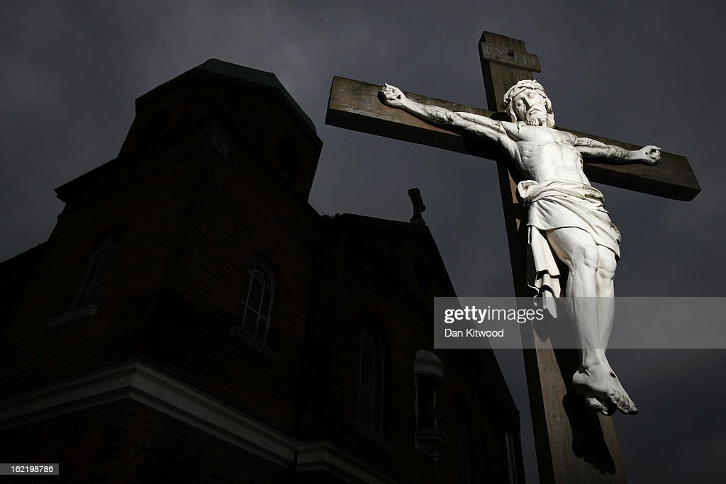 A general view of a crucifix bearing an image of Christ outside St Mary Magdalen Catholic Church in Brockley on February 20, 2013 in London, England.