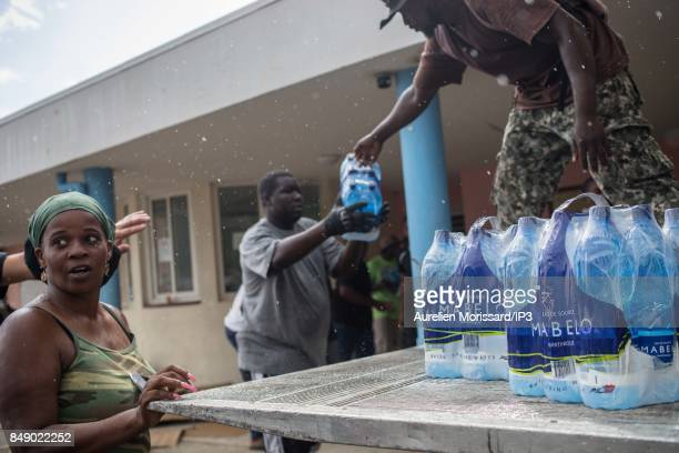 A general view of a distribution of water in front of Saint Martin III's College in the Orleans neighborhood eleven days after the passage of...
