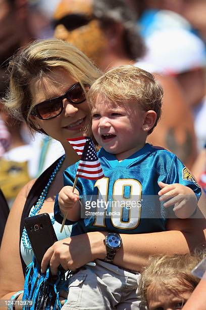 A general view of a fan waving a flag remembering the 9/11 attacks ahead of the Tennessee Titans versus Jacksonville Jaguars during their season...