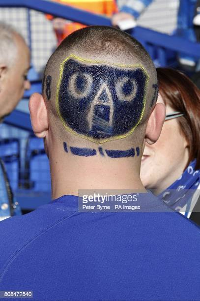General view of a fan who has the emblem shaved into the back of his head
