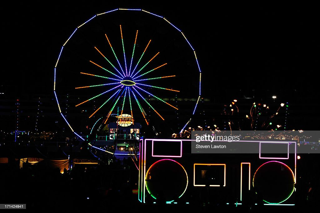 A general view of a Ferris wheel and the Rockbox art car at the 17th annual Electric Daisy Carnival at Las Vegas Motor Speedway on June 23, 2013 in Las Vegas, Nevada.