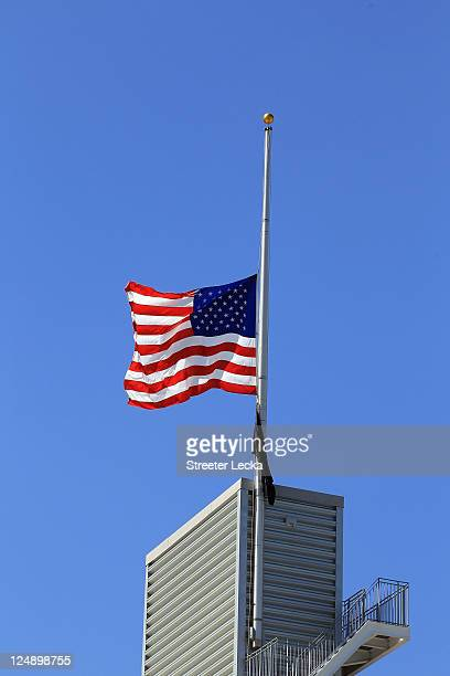 A general view of a flag at half mast remembering the 9/11 attacks before the Tennessee Titans versus Jacksonville Jaguars during their season opener...