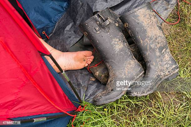 General view of a foot and wellington boots by a tent at the Glastonbury Festival at Worthy Farm Pilton on June 28 2015 in Glastonbury England Now...