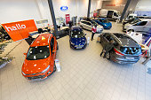 A general view of a Ford car showroom on January 3 2015 in The Hague The Netherlands BOVAG The Dutch association of car dealers expects that in the...