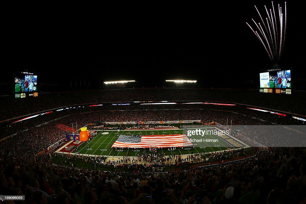 General view of a giant American Flag is displayed as fireworks go off prior to the start of the 2013 Discover BCS National Championship game between the Alabama Crimson Tide and the Notre Dame Fighting Irish at Sun Life Stadium on January 7, 2013 in Miami Gardens, Florida.