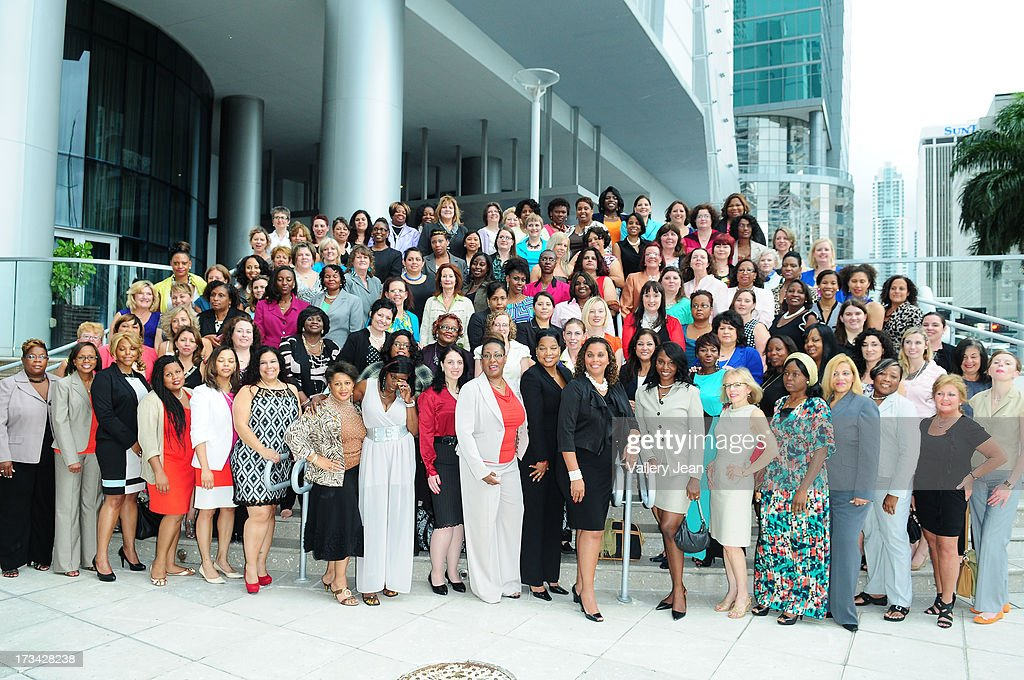 General view of a group portrait of Dress for Success Delegates From Around the World attend The 9th Annual Success Summit hosted by Dress For Success Worldwide at Epic Hotel on July 13, 2013 in Miami, Florida.