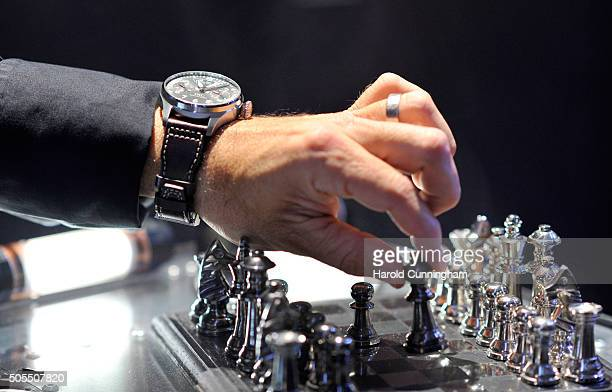 A general view of a guest playing chess at the IWC booth ahead of the launch of the Pilot's Watches Novelties from the Swiss luxury watch...
