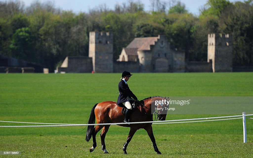 General view of a horse and rider during the Mitsubishi Motors Cup Show Jumping during Day One of the Badminton Horse Trials on May 4, 2016 in Badminton, Untied Kindom.