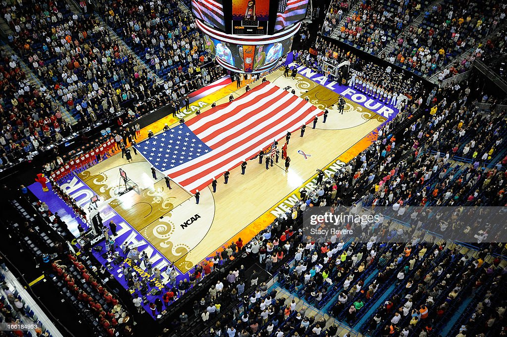 A general view of a large American flag on the court during the National Anthem before the 2013 NCAA Women's Final Four Championship between the Connecticut Huskies and the Louisville Cardinals at New Orleans Arena on April 9, 2013 in New Orleans, Louisiana.