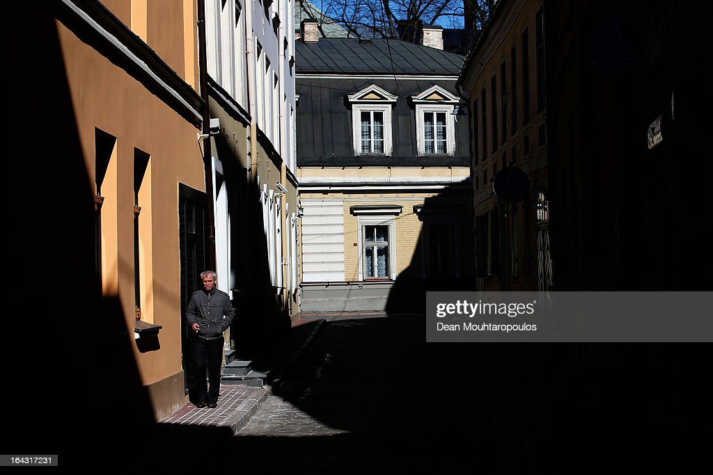 A general view of a local walking in a street next to The Art Museum 'Riga Bourse' near Dome Square on March 22, 2013 in Riga, Latvia.