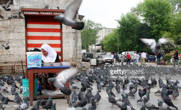 A general view of a local woman selling bird seed on the streets of Istanbul Turkey