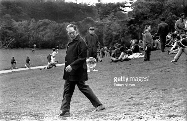 General view of a man walking on Hippie Hill with a bubble sticking to him circa February 1969 at Golden Gate Park in San Francisco California
