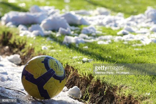 General view of a matchball and snow around the side of the Fratton Park pitch