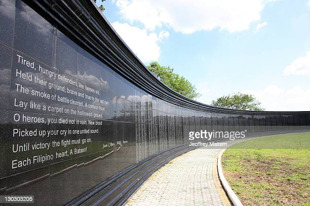 General view of a memorial wall inscribed with names of Filipino and US soldiers who died as prisoners of war from the Bataan Death March during...