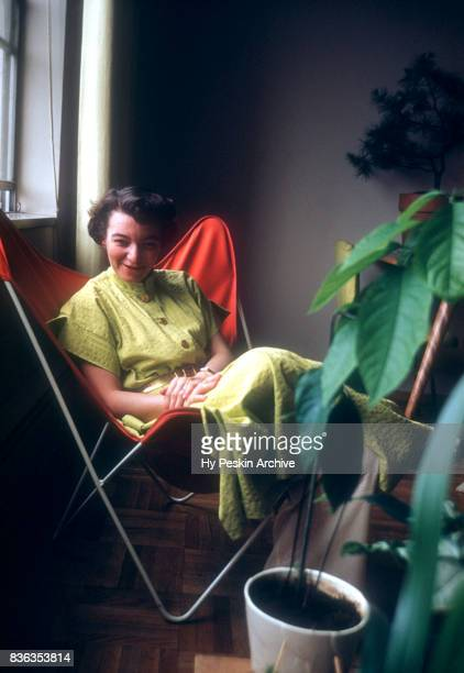 General view of a model posing as she sits in a chair on March 22 1955
