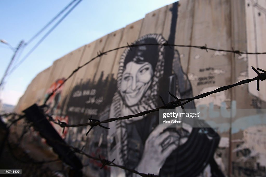 General view of a mural of Leila Khaled, a member of the Popular Front for the Liberation of Palestine (PFLP) and member of the Palestinian National Council, on the apartheid wall on June 16, 2013 in Bethlehem, West Bank.