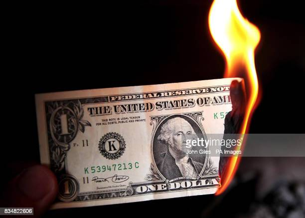 A general view of a One Dollar bill burning President George Bush will meet both of his potential successors and political leaders at the White House...