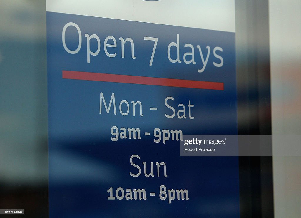 A general view of a open hours sign on November 20, 2012 in Melbourne, Australia. The National Retail Association is meeting with Fair Work Australia this week to discuss cutting or reducing penalty rates - increased wages paid to workers who work late night and Sunday hours - claiming that the rates are not suited for modern day Australia. Retail workers currently earn double time for working Sundays and weekday hours past 6:00pm.