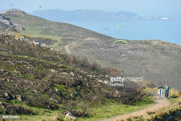 A general view of a part of BrayGreystones cliff walk with a view of Bray Head in the background and people enjoying Paragliding On Sunday March 26...