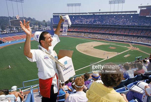 A general view of a peanut vendor selling peanuts to fans during a game at Dodger Stadium in Los Angeles California