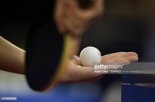 General view of a player holding a Table Tennis paddle and ball preparing to serve