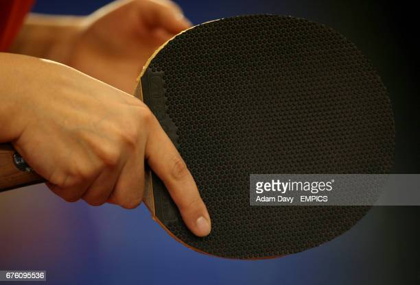 General view of a player holding a Table Tennis paddle preparing to serve