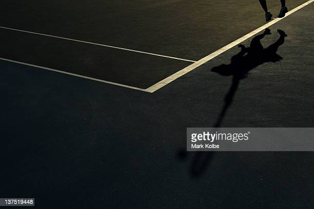 A general view of a players shadow during day seven of the 2012 Australian Open at Melbourne Park on January 22 2012 in Melbourne Australia