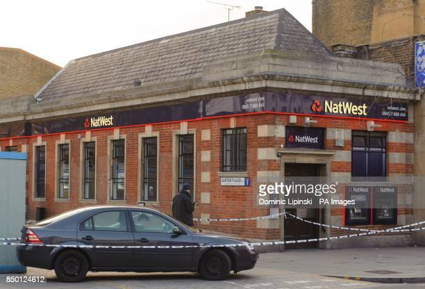 General view of a police cordon outside a branch of Natwest on Walworth Road in Walworth south London where an armed robbery took place earlier today