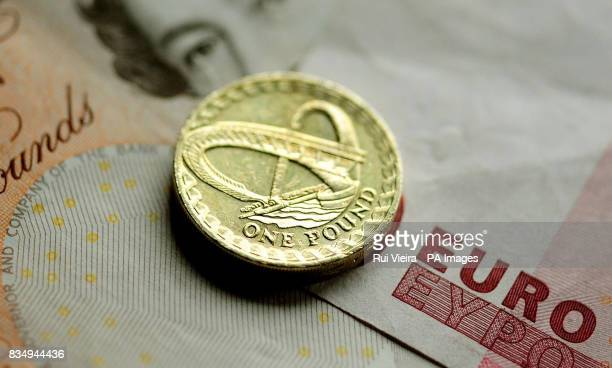 A general view of a pound coin on a 10 note and a 10 Euro note
